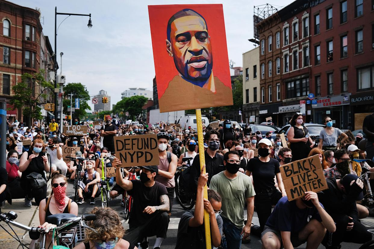 Protesters march in downtown Brooklyn over the killing of George Floyd by a Minneapolis Police officer on June 05, 2020 in New York City. (Spencer Platt/Getty Images)