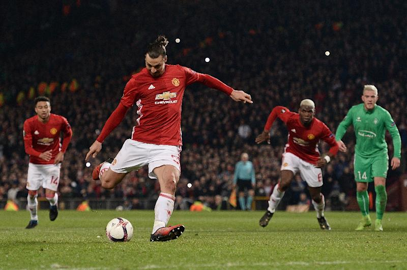 Manchester United's Swedish striker Zlatan Ibrahimovic shoots from the penalty spot to score his team's third goal during the UEFA Europa League Round of 32 first-leg football match against Saint-Etienne February 16, 2017