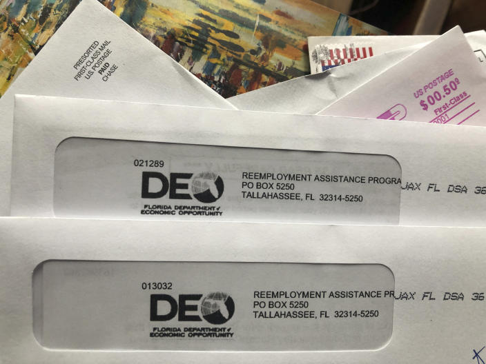 Envelopes from the Florida Department of Economic Opportunity Reemployment Assistance Program are shown, Thursday, Nov. 5, 2020, in Surfside, Fla. The number of a Americans applying for unemployment benefits rose last week to 778,000, evidence that the U.S. economy and job market remain under strain as coronavirus cases surge and colder weather heighten the risks. (AP Photo/Wilfredo Lee)