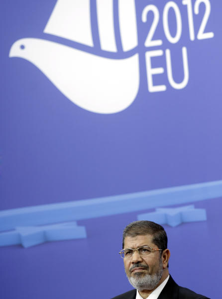Egyptian President Mohamed Morsi listens to questions during a media conference at the EU Council building in Brussels on Thursday, Sept. 13, 2012. (AP Photo/Virginia Mayo)