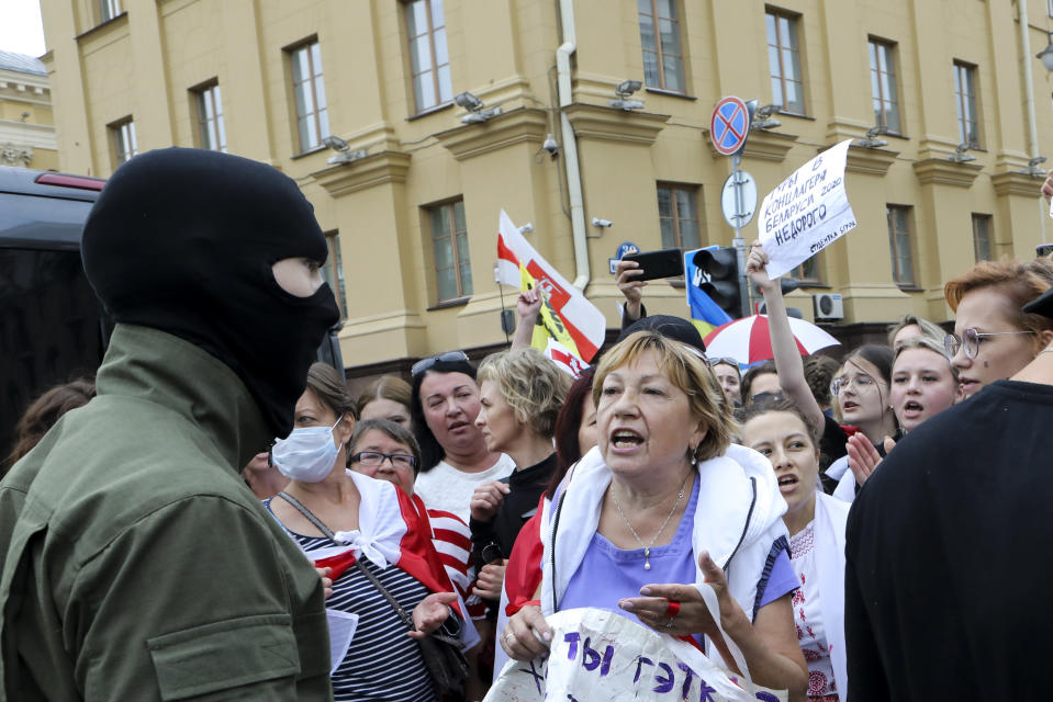 A woman argues with a police officer during an opposition rally to protest the official presidential election results in Minsk, Belarus, Saturday, Sept. 5, 2020. Women's marches and demonstrations have become a regular feature of the four weeks of protest that have shaken Belarus following a disputed election that gave Belarusian President Alexander Lukashenko a sixth term in office. (AP Photo)