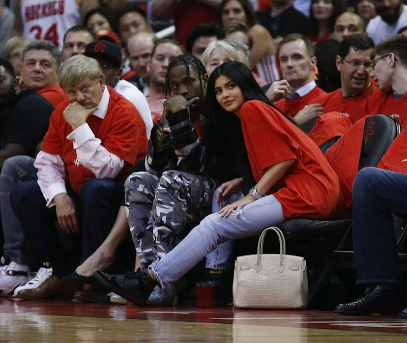 Houston rapper Travis Scott and Kylie Jenner watch courtside during Game Five of the Western Conference Quarterfinals game of the 2017 NBA Playoffs at Toyota Center on April 25, 2017 in Houston, Texas. Source: Getty