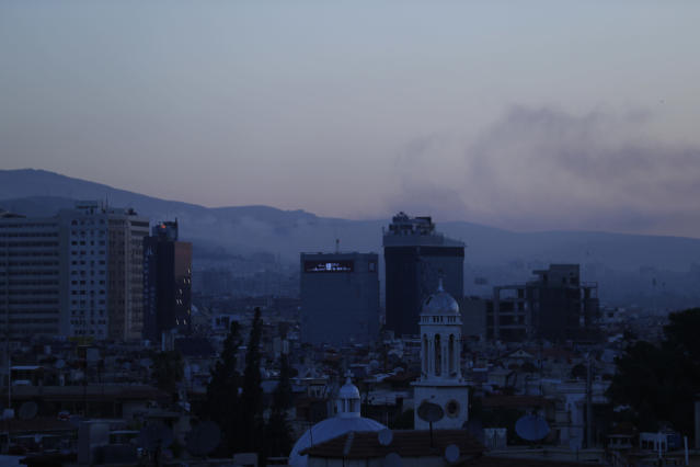 <p>Smoke rises after airstrikes targeting different parts of the Syrian capital Damascus, Syria, early Saturday, April 14, 2018. (Photo: Hassan Ammar/AP) </p>