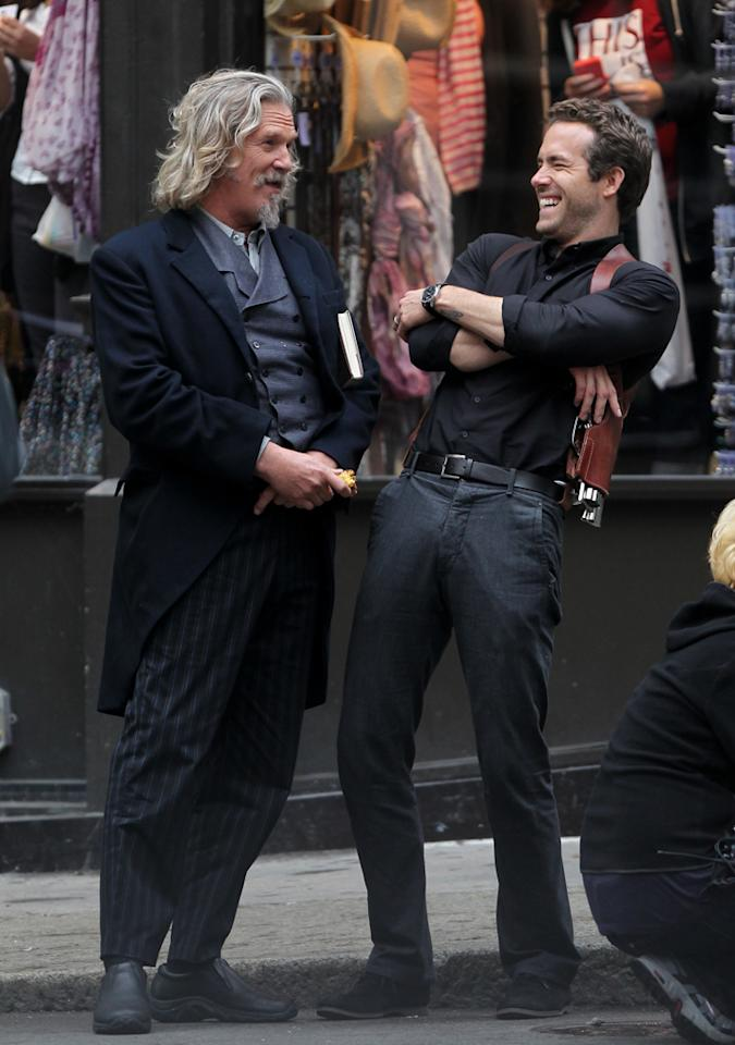 "Oscar winner Jeff Bridges (""Crazy Heart"") shares a laugh with Ryan Reynolds in between takes on the set of their upcoming movie, ""R.I.P.D."" <a href=""http://www.splashnewsonline.com"" target=""new"">Splash News</a> - October 2, 2011"