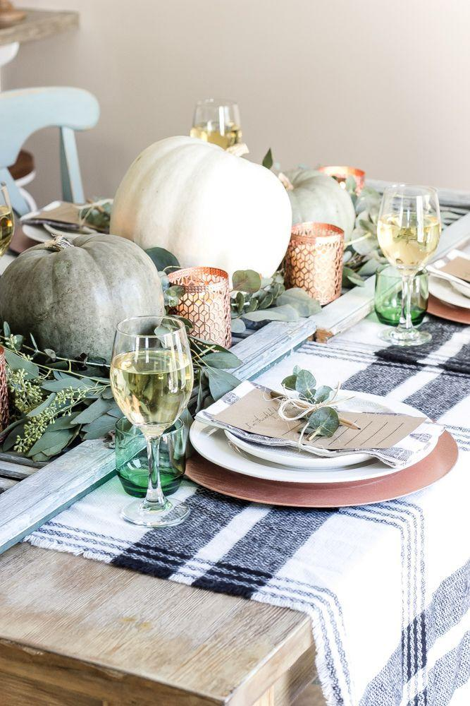 """<p>A green and copper color palette makes for a warm, inviting <a href=""""https://www.countryliving.com/entertaining/g634/thanksgiving-table-settings-1108/"""" rel=""""nofollow noopener"""" target=""""_blank"""" data-ylk=""""slk:Thanksgiving table setting"""" class=""""link rapid-noclick-resp"""">Thanksgiving table setting</a>, and kraft paper cards at each place encourage guests to jot down their blessings. Even better: Almost everything can be sourced from the dollar store and grocery store!</p><p><strong>Get the tutorial at <a href=""""https://www.blesserhouse.com/green-and-copper-thanksgiving-tablescape-printable/"""" rel=""""nofollow noopener"""" target=""""_blank"""" data-ylk=""""slk:Bless'er House"""" class=""""link rapid-noclick-resp"""">Bless'er House</a>.</strong></p><p><a class=""""link rapid-noclick-resp"""" href=""""https://www.lionsdeal.com/tab-trg-6651.html"""" rel=""""nofollow noopener"""" target=""""_blank"""" data-ylk=""""slk:SHOP CHARGER PLATES"""">SHOP CHARGER PLATES</a></p>"""
