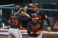 Baltimore Orioles' Renato Nunez (39) celebrates with teammate Anthony Santander (25) after hitting a three-run home run during the sixth inning of a baseball game against the Washington Nationals in Washington, Friday, Aug. 7, 2020. (AP Photo/Manuel Balce Ceneta)