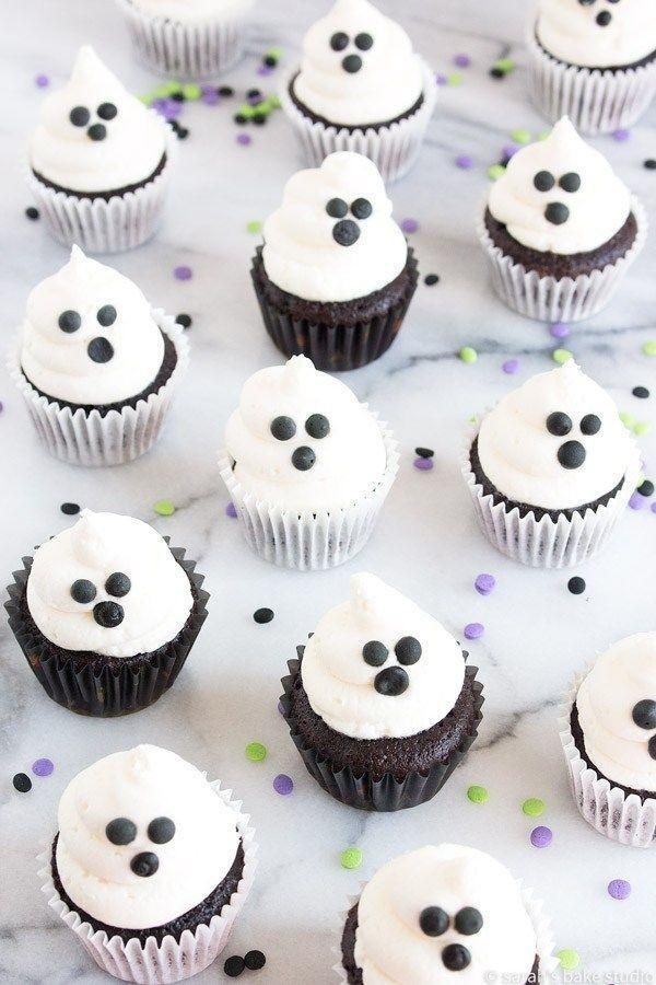 """<p>These fa-<em>boo</em>-lous cupcakes are scary-easy to decorate. Just top chocolate cupcakes with marshmallow frosting and make a face with chocolate chips.</p><p><strong>Get the recipe at <a href=""""https://sarahsbakestudio.com/mini-ghost-cupcakes/"""" rel=""""nofollow noopener"""" target=""""_blank"""" data-ylk=""""slk:Sarah's Bake Studio"""" class=""""link rapid-noclick-resp"""">Sarah's Bake Studio</a>.</strong></p><p><strong><a class=""""link rapid-noclick-resp"""" href=""""https://www.amazon.com/Pastry-Pack-16-Inch-Cupcake-Decorating-Bags-Disposable/dp/B01HQ9T4H2/?tag=syn-yahoo-20&ascsubtag=%5Bartid%7C10050.g.1366%5Bsrc%7Cyahoo-us"""" rel=""""nofollow noopener"""" target=""""_blank"""" data-ylk=""""slk:SHOP PASTRY BAGS"""">SHOP PASTRY BAGS</a><br></strong></p>"""
