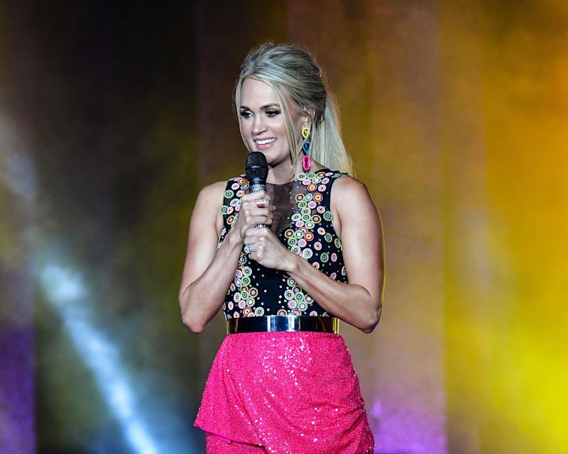 Carrie Underwood poses on stage