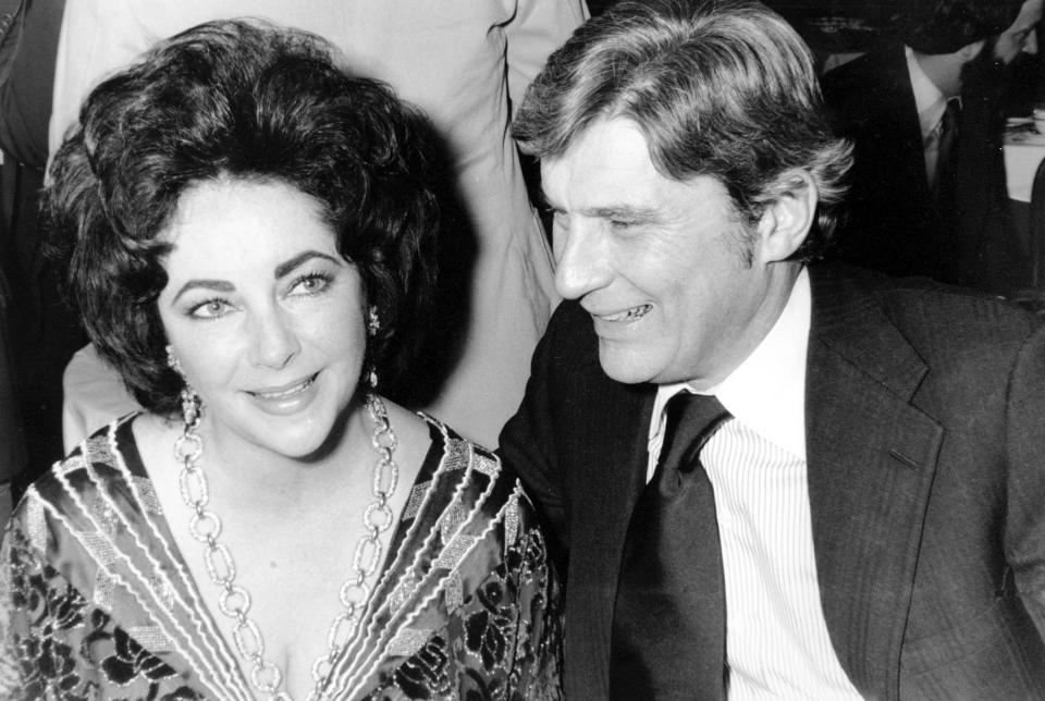 FILE - In this Jan. 30, 1977 file photo actress Elizabeth Taylor and her husband, former secretary of the U.S. Navy John Warner attend the 42nd New York Film Critics Circle Awards dinner in New York. Warner, one of the Senate's most influential military experts, died Tuesday, May 25, 2021, at age 94, his longtime chief of staff said Wednesday, May 26. (AP Photo/File)