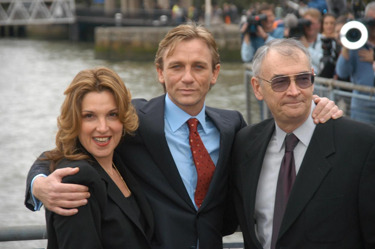 Actor Daniel Craig (centre), being presented to the press  at St Catharines's dock as the new James Bond alongside producers Barbara Boccoli, Michael G Wilson, London, 14 October 2005. (Photo by Phil Dent/Redferns)