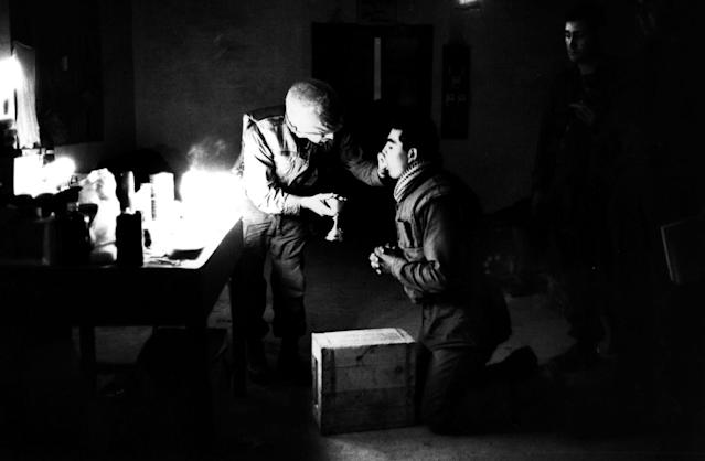 <p>Marine chaplain Eli Tavesian giving communion to marine Louis A Loya, at Forward Command Post in Hue, Vietnam. (Photo: Terry Fincher/Daily Express/Hulton Archive/Getty Images) </p>