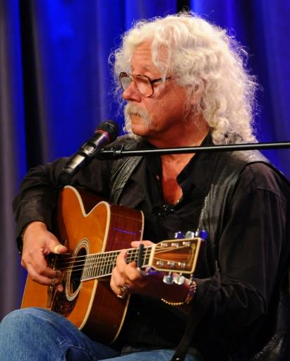 Arlo Guthrie, among the artists who played at 1969's Woodstock, performs at The Grammy Museum in Los Angeles in 2012