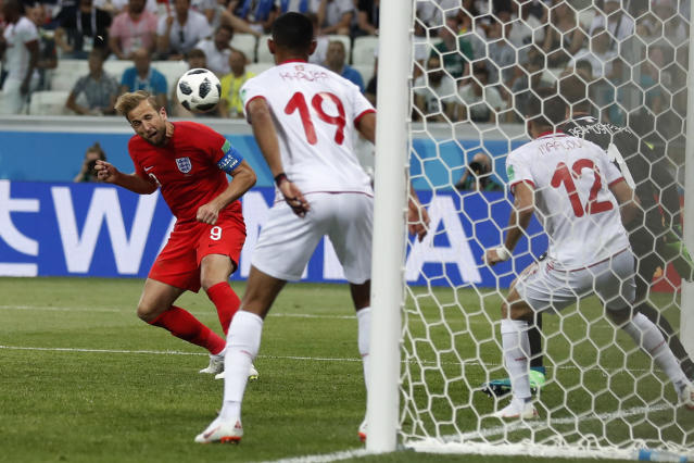 England's Harry Kane scores his side's 2nd goal against Tunisia during a group G match at the 2018 soccer World Cup in the Volgograd Arena in Volgograd, Russia, Monday, June 18, 2018. (AP Photo/Alastair Grant)