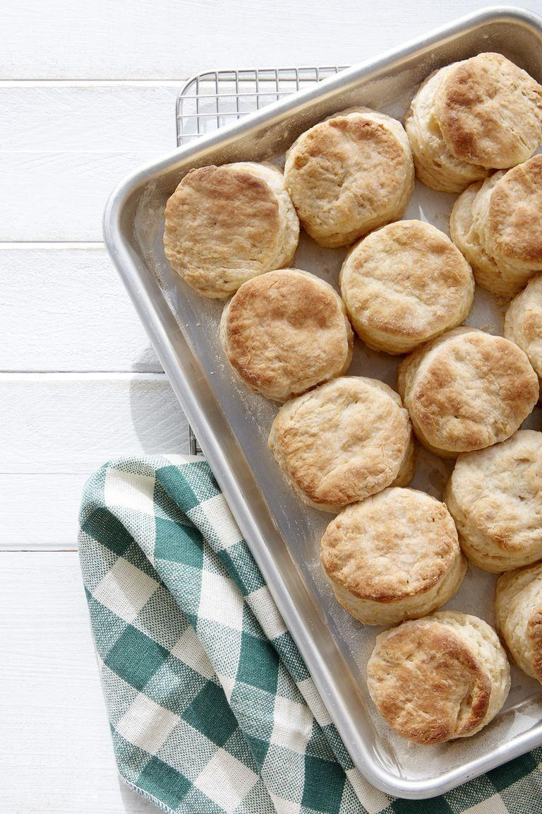 """<p>No brunch is complete without some buttery, flaky biscuits. Spread some homemade jam on top for the most delicious bite.</p><p><strong><a href=""""https://www.countryliving.com/food-drinks/a19040029/mile-high-flaky-biscuits-recipe/"""" rel=""""nofollow noopener"""" target=""""_blank"""" data-ylk=""""slk:Get the recipe"""" class=""""link rapid-noclick-resp"""">Get the recipe</a>.</strong></p><p><strong><a class=""""link rapid-noclick-resp"""" href=""""https://www.amazon.com/Glass-Butter-Dish-with-Cover/dp/B01HST436W/?tag=syn-yahoo-20&ascsubtag=%5Bartid%7C10050.g.1642%5Bsrc%7Cyahoo-us"""" rel=""""nofollow noopener"""" target=""""_blank"""" data-ylk=""""slk:SHOP BUTTER DISHES"""">SHOP BUTTER DISHES</a><br></strong></p>"""
