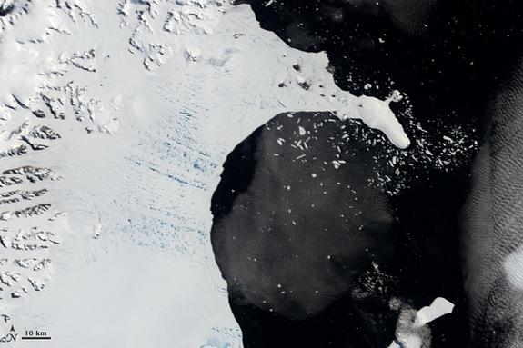 The Larsen B ice shelf on January 31, 2002. Melt ponds dot its surface. Scroll down for an after picture.