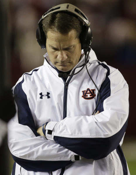 Auburn coach Gene Chizik walks the sidelines during the second half of a 49-0 loss to Alabama in a NCAA college football game at Bryant-Denny Stadium in Tuscaloosa, Ala., Saturday, Nov. 24, 2012. Chizik was fired Sunday after a 3-8 season by Athletic Director Jay Jacobs. (AP Photo/Dave Martin)