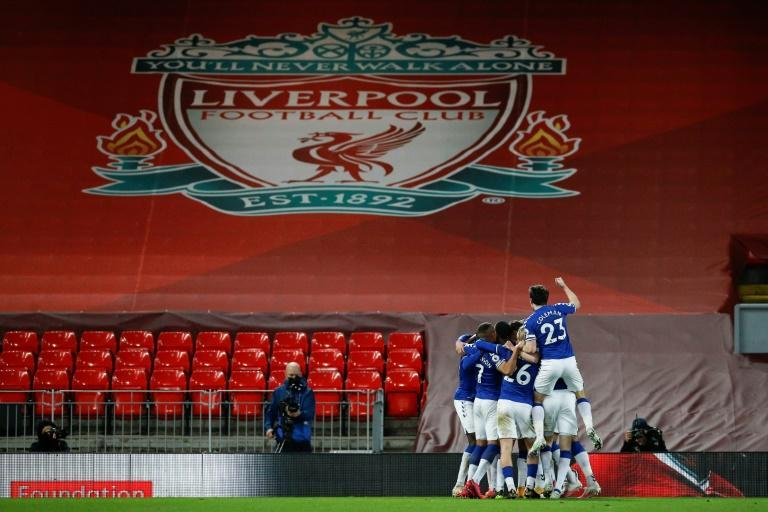 Everton players celebrate a first win at Anfield since 1999 in front of empty stands