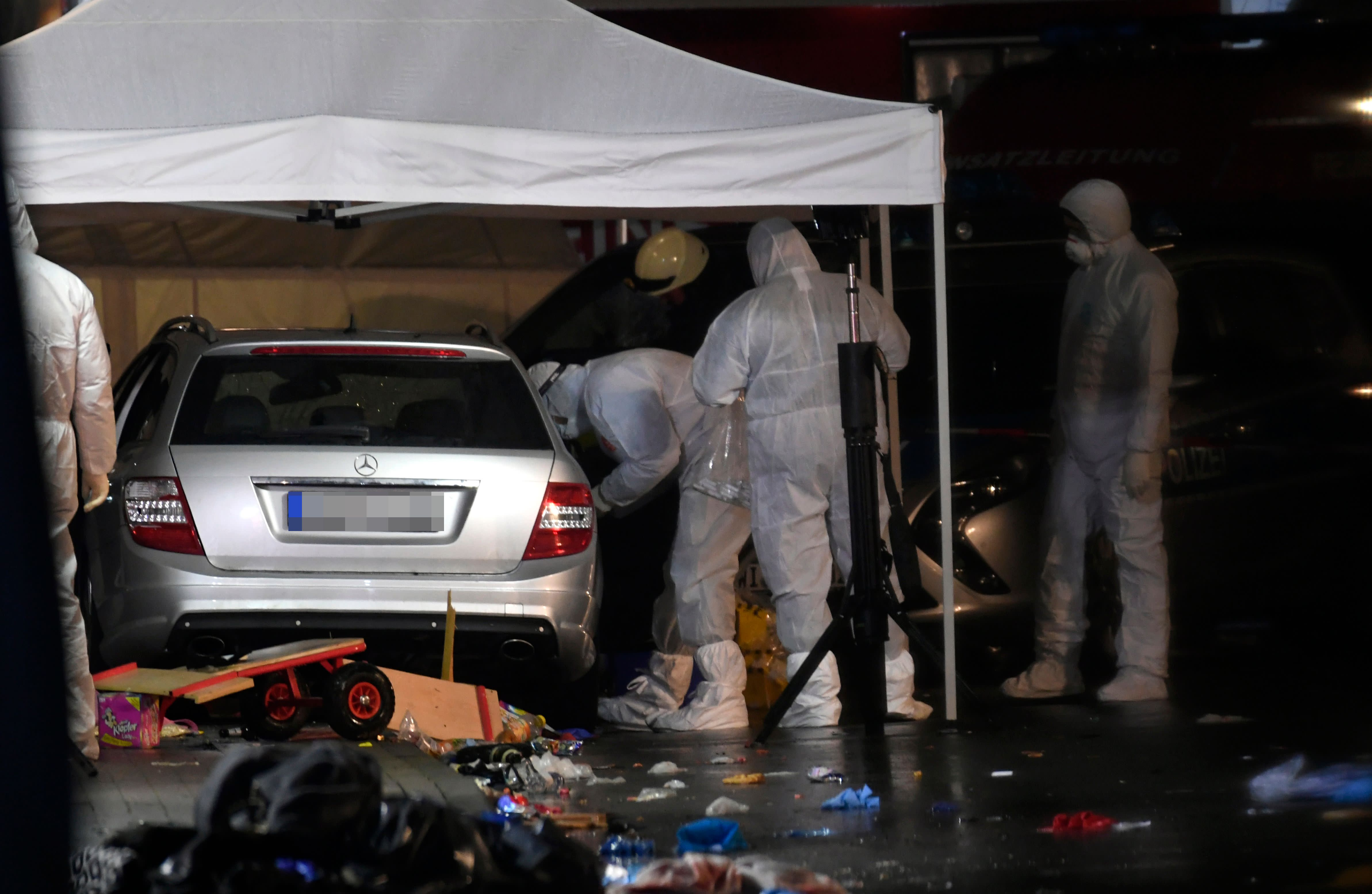Police officers investigate the car of the man who drove into a carnival procession on February 24, 2020 in Volkmarsen near Kassel, central Germany. - Several people were injured when a car drove into a carnival procession in Volksmarsen, police said, adding that the driver had been arrested. (Photo by INA FASSBENDER / AFP) (Photo by INA FASSBENDER/AFP via Getty Images)
