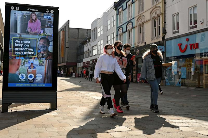 Pedestrians and shoppers wear face masks in north-east England: AFP via Getty Images