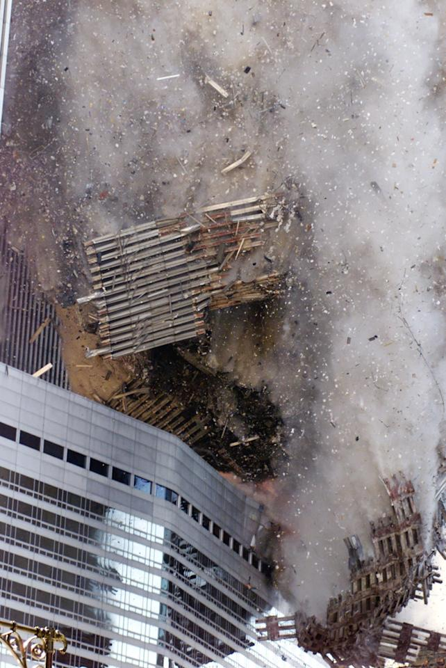 The south tower of New York's World Trade Center collapses Tuesday Sept. 11, 2001. In one of the most horrifying attacks ever against the United States, terrorists crashed two airliners into the World Trade Center in a deadly series of blows that brought down the twin 110-story towers. (AP Photo/Richard Drew)