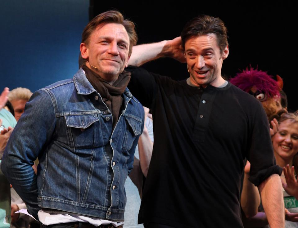 NEW YORK - DECEMBER 08:  Daniel Craig and Hugh Jackman accept their top fundraising award for raising 1.5 million dollars setting a record at The 2009 Broadway Cares/Equity Fights AIDS Gypsy Of The Year Competition at The Palace Theater on December 8, 2009 in New York City.  (Photo by Bruce Glikas/FilmMagic)