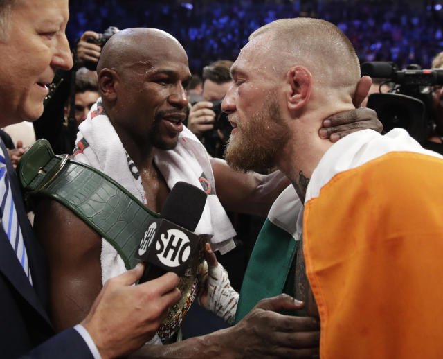 <p>Floyd Mayweather Jr., left, embraces Conor McGregor after a super welterweight boxing match Saturday, Aug. 26, 2017, in Las Vegas. (AP Photo/Isaac Brekken) </p>
