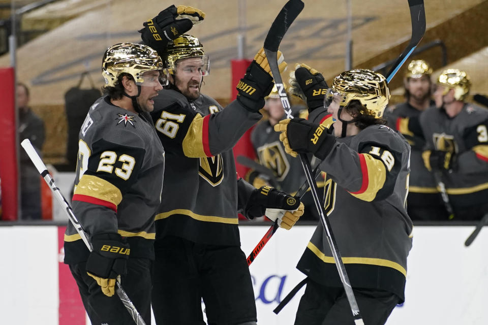 Vegas Golden Knights players celebrate after defenseman Alec Martinez (23) scored against the St. Louis Blues during the second period of an NHL hockey game Friday, May 7, 2021, in Las Vegas. (AP Photo/John Locher)