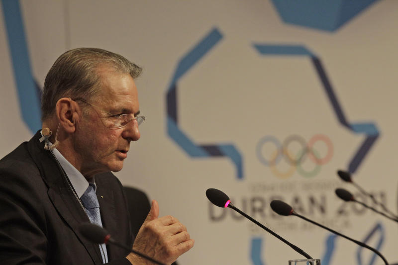 International Olympic Committee President Jacques Rogge speaks during a press conference in Durban, South Africa, Monday, July 4, 2011.  Munich has called in German football great Franz Beckenbauer for its final push to host the 2018 Winter Olympics. Munich Bid Committee Chair Katarina Witt says Beckenbauer will arrive in Durban on Tuesday, a day before IOC members vote on whether Munich; Annecy in France; or Pyeongchang in South Korea will stage the games. (AP Photo/Schalk van Zuydam)