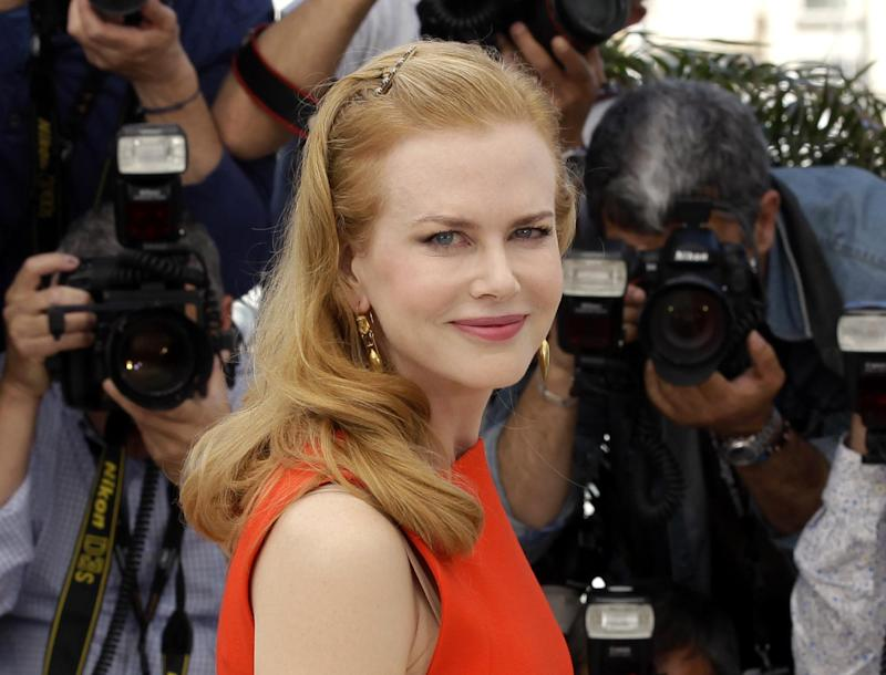 "FILE - This May 24, 2012 file photo shows actress Nicole Kidman poses during a photo call for ""The Paperboy"" at the 65th international film festival, in Cannes, southern France. Kidman is being honored by the New York Film Festival in a gala tribute.  The Film Society of Lincoln Center announced Tuesday, Aug. 21,  that Kidman will be celebrated at the 50th-annual New York Film Festival. The festival will also honor its longtime director Richard Pena in a second gala. (AP Photo/Lionel Cironneau, file)"