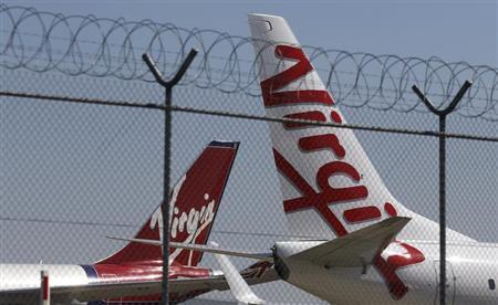 Virgin planes are parked next to each other at Kingsford Smith airport in Sydney