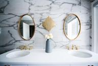 <p>Mirrors are a must in the bathroom, for sure, but they also double as lovely decor that gives the illusion that <i>any</i> space is bigger than it is. Score!</p>