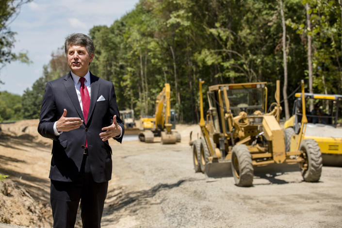 """In this July 25, 2018, photo, Stephen Bell, president and CEO of the Arkadelphia Area Chamber of Commerce, talks about a new railroad spur that is being built to support the needs of what he hopes will be a new paper mill, one of several Chinese-backed deals Arkansas has landed in recent years, in Arkadelphia, Ark. State and local officials in Arkansas are scrambling to preserve development deals with Chinese companies amid President Donald Trump's escalating tariff battle. """"It's like a dark cloud hanging over the future of the project,"""" Bell said. """"Right now, the clouds are off on the horizon. But I think no one knows where the trade situation is going right now."""" (AP Photo/Karen E. Segrave)"""