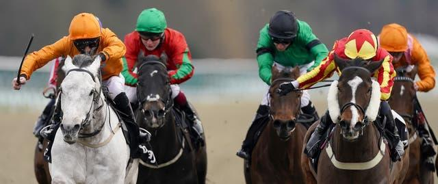 Rhys Clutterbuck riding Cappananty Con (left) wins The Betway Handicap at Lingfield Park Racecourse
