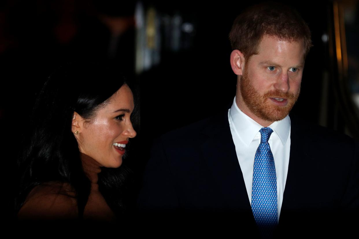 Britain's Prince Harry, Duke of Sussex and Meghan, Duchess of Sussex gesture as they leave after a visit to Canada House in thanks for the warm Canadian hospitality and support they received during their recent stay in Canada, in London on January 7, 2020. (Photo by Adrian DENNIS / AFP) (Photo by ADRIAN DENNIS/AFP via Getty Images)
