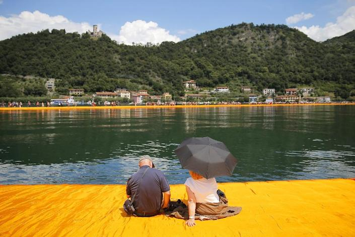 'The Floating Piers' created by artist Christo Vladimirov Javacheff on Iseo Lake, in northern Italy, is made of 200,000 floating cubes (AFP Photo/Marco Bertorello)