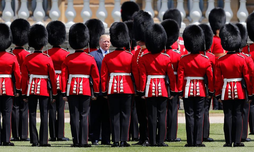 President Donald Trump reviews an honor guard during a ceremonial welcome in the garden of Buckingham Palace in London, Monday, June 3, 2019 on the opening day of a three day state visit to Britain. (Photo: Frank Augstein/AP)