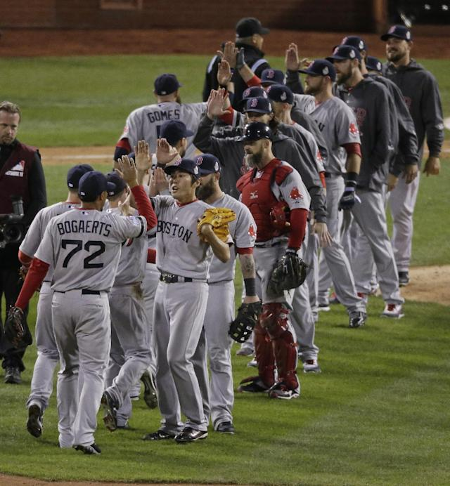 The Boston Red Sox celebrate after defeating the St. Louis Cardinals in Game 5 of baseball's World Series Monday, Oct. 28, 2013, in St. Louis. The Red Sox won 3-1 to take a 3-2 lead in the series. (AP Photo/Charlie Riedel)