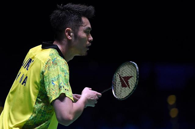 Eye on the title: China's Lin Dan beats compatriot Huang Yuxiang and is now just one victory away from a seventh All England badminton title (AFP Photo/PAUL ELLIS)