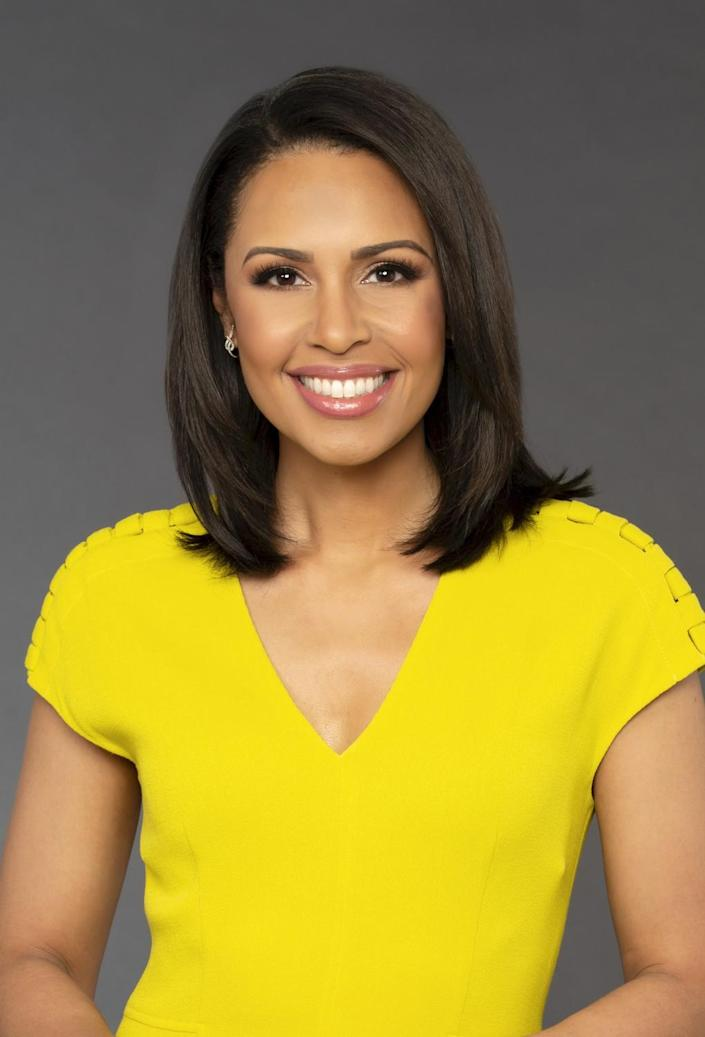 A woman in a bright yellow dress