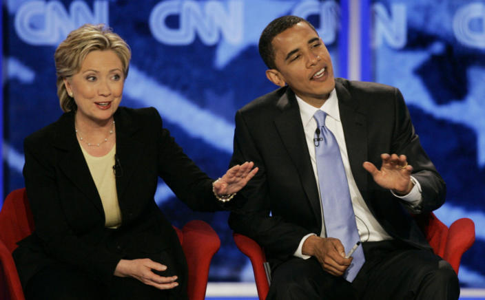 <p>Democratic presidential hopefuls Sens. Hillary Clinton, left, and Barack Obama, answer a question simultaneously during the Democratic presidential primary debate hosted by Saint Anselm College in Manchester, N.H., in June 2007. (Photo: Charles Krupa/AP)</p>
