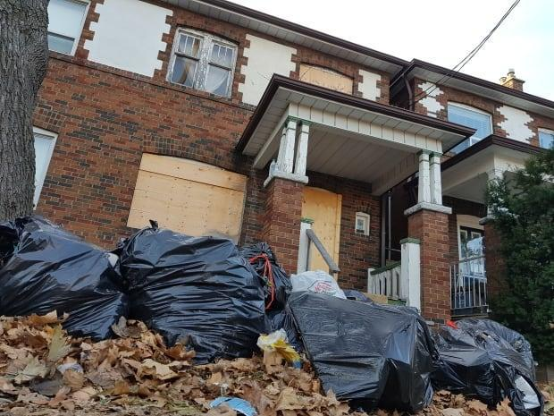 An abandoned house on Carling Avenue in the Bloor Street West and Ossington Avenue area. Several levels of government have proposed or are implementing taxes on vacant properties. (Mike Smee/CBC - image credit)