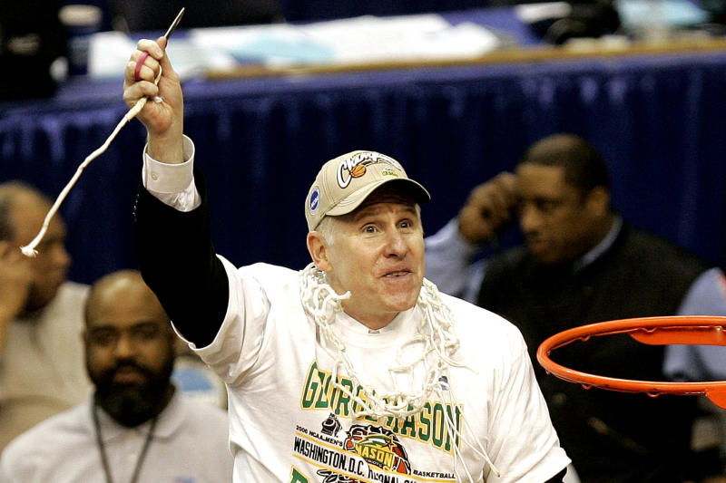 FILE - In this March 25, 2006, file photo, George Mason head coach Jim Larranaga finishes cutting the net after beating Connecticut 86-84 in overtime during the fourth round of the NCAA basketball tournament in Washington. (AP Photo/Susan Walsh, File)