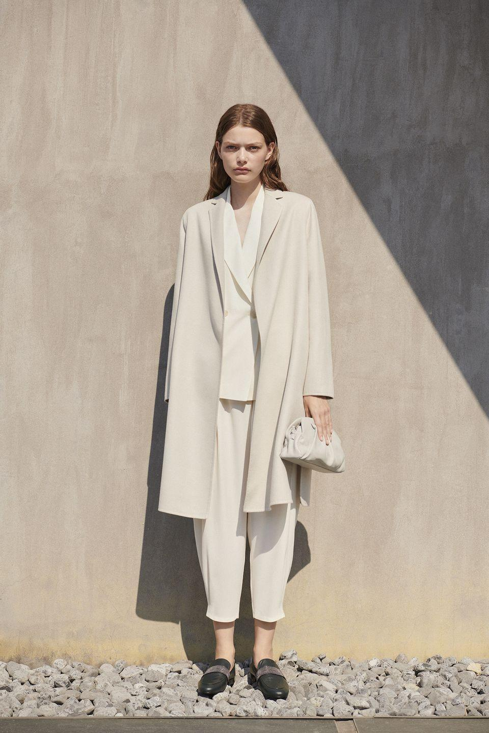 <p>Fabiana Filippi turned down the volume for spring 2021, showing a collection, titled The Perfect Rhythm of Nature, that focuses on uncluttered forms and soft hues. From an elegant Grecian-draped slip in beige and a pleated skirt-and-top combo in mauve to a sleek sky blue coat and a refined brocade dress with a sarong skirt, the Italian label proved that one need not shout to make an impact. —<em>Barry Samaha</em></p>