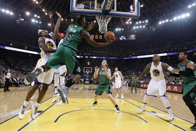 Boston Celtics' Jeff Green (8) drives to the basket next to Golden State Warriors' Harrison Barnes (40) during the first half of an NBA basketball game Friday, Jan. 10, 2014, in Oakland, Calif. (AP Photo/Marcio Jose Sanchez)