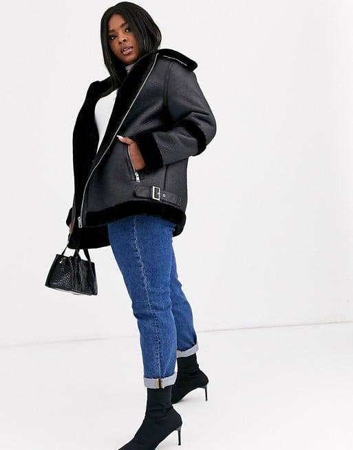 """<p>Everyone will want to borrow this cool <a href=""""https://www.popsugar.com/buy/ASOS-Design-Bonded-Aviator-Coat-497464?p_name=ASOS%20Design%20Bonded%20Aviator%20Coat&retailer=asos.com&pid=497464&price=119&evar1=fab%3Aus&evar9=46708574&evar98=https%3A%2F%2Fwww.popsugar.com%2Fphoto-gallery%2F46708574%2Fimage%2F46710664%2FASOS-Design-Bonded-Aviator-Coat&list1=shopping%2Cfall%20fashion%2Ccoats%2Cfall%2Ccurve%2Ccurve%20fashion&prop13=api&pdata=1"""" rel=""""nofollow"""" data-shoppable-link=""""1"""" target=""""_blank"""" class=""""ga-track"""" data-ga-category=""""Related"""" data-ga-label=""""https://www.asos.com/us/asos-curve/asos-design-curve-bonded-aviator-coat-in-black/prd/11745548?clr=black&amp;colourWayId=16413477&amp;SearchQuery=&amp;cid=9577"""" data-ga-action=""""In-Line Links"""">ASOS Design Bonded Aviator Coat</a> ($119). </p> <p><br></p> <p><br></p> <p>Buy now!<br></p>"""