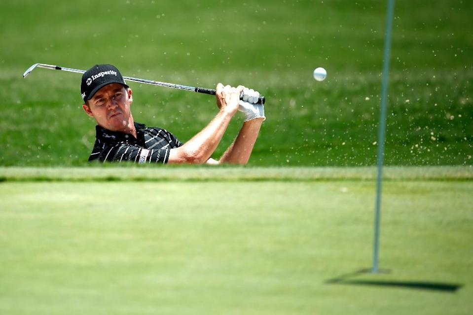 Jimmy Walker of the US hits out of the bunker on the seventh hole during the final round of the AT&T Byron Nelson, at the TPC Four Seasons Resort Las Colinas, in Irving, Texas, on May 31, 2015 (AFP Photo/Scott Halleran)