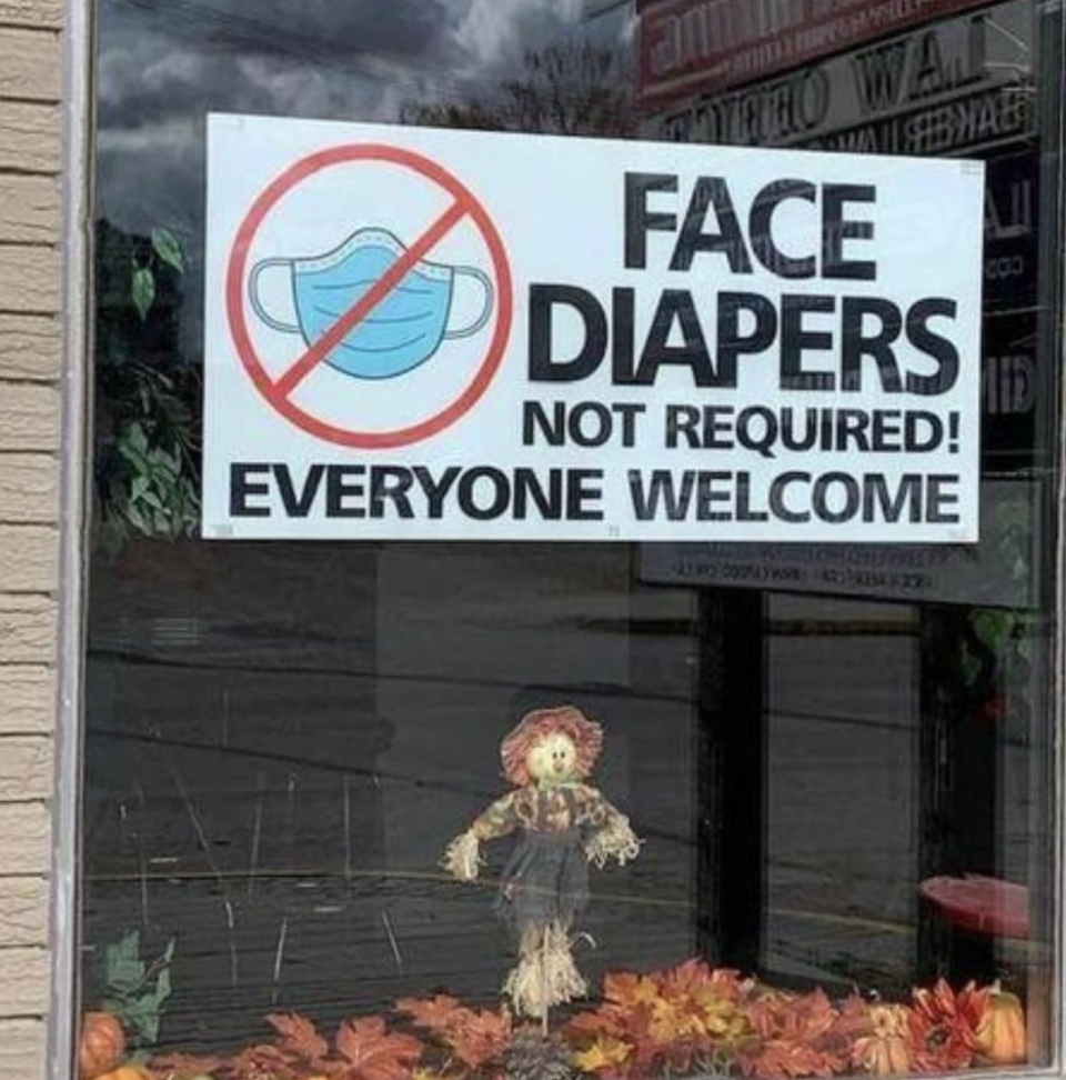 """The sign in the window reading """"Face diapers not required! Everyone welcome"""". Source: Facebook"""