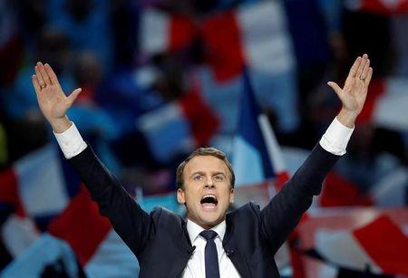 FILE PHOTO: Emmanuel Macron, head of the political movement En Marche !, or Onwards !, and candidate for the 2017 French presidential election, attends a campaign political rally in Paris
