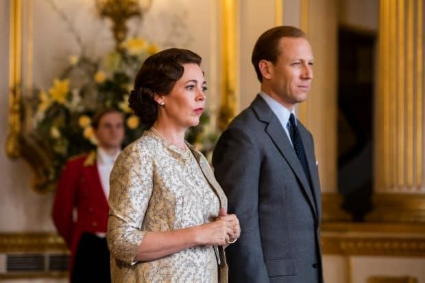 Tobias Menzies, right, plays Prince Philip in Season 3 of The Crown, along with Olivia Colman as Queen Elizabeth. (Netflix - image credit)