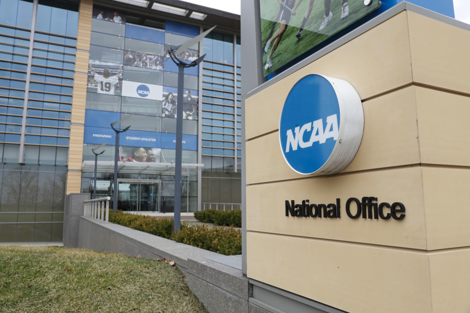FILE - The NCAA headquarters in Indianapolis is shown in this Thursday, March 12, 2020, file photo. The Associated Press has learned that the NCAA has not tested players for performance-enhancing drugs while theyve been at March Madness and other recent college championships. Three people familiar with testing protocols tell AP full-scale testing has not resumed since the coronavirus pandemic shut down college sports a year ago. (AP Photo/Michael Conroy, File)